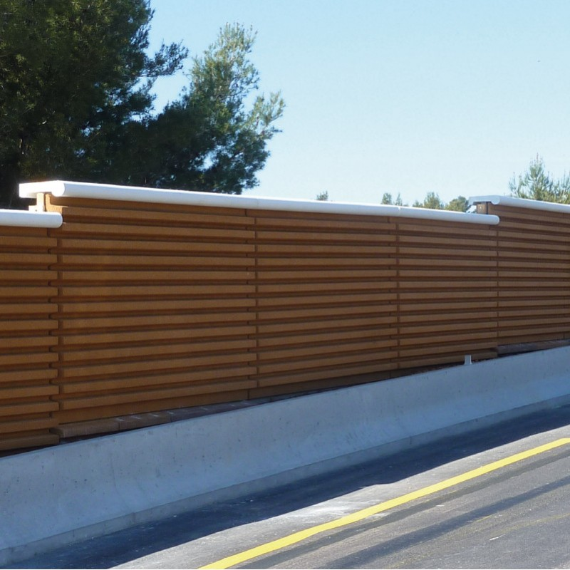 Noise barrier with stabilized wood aggregates